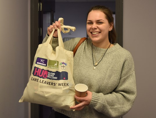 Young care leaver with bags of information and useful items